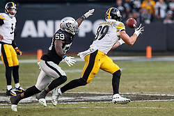 OAKLAND, CA - DECEMBER 09: Tight end Vance McDonald #89 of the Pittsburgh Steelers catches a pass in front of linebacker Tahir Whitehead #59 of the Oakland Raiders during the third quarter at the Oakland Coliseum on December 9, 2018 in Oakland, California. The Oakland Raiders defeated the Pittsburgh Steelers 24-21. (Photo by Jason O. Watson/Getty Images) *** Local Caption *** Vance McDonald; Tahir Whitehead