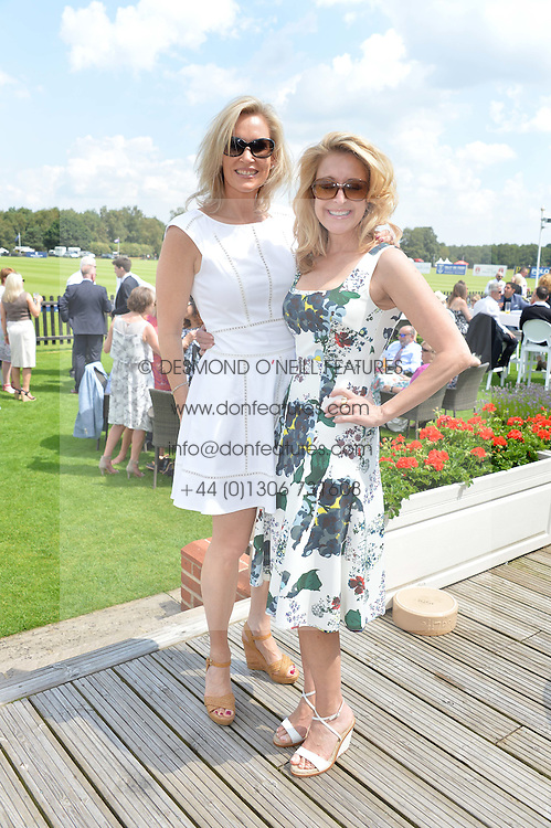 Left to right, TIA GRAHAM and JENNIFER PLOSZAJ at The Royal Salute Coronation Cup Polo held at Guards Polo Club,  Smiths Lawn, Windsor Great Park, Egham on 23rd July 2016.