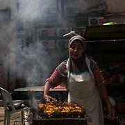 A food hawker preparing Ayam Percik at back lane of Jalan Petaling in Kuala Lumpur on November 22, 2017.