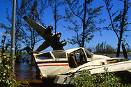 Aircraft damaged at Norman Manley airport in Kingston in September 1988 after Hurricane Gilbert hit Jamaica. By the time the destruction had stopped, 45 people were dead and over 500,000 left homeless. Agriculture was devastated, with US$50 million in damage to coffee, sugar cane, banana and other crops. Looting was widespread, particularly in Kingston. Foreign aid of about US$125 million form the USA alone poured into the stricken island. The tourist parts of the island were returned to normal with remarkable speed, but others took much longer to recover from the devastation.