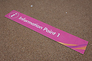 A fallen Information Point sign lying on the ground, on 16th August 2017, in the Queen Elizabeth Olympic Park, Stratford, East London, England.