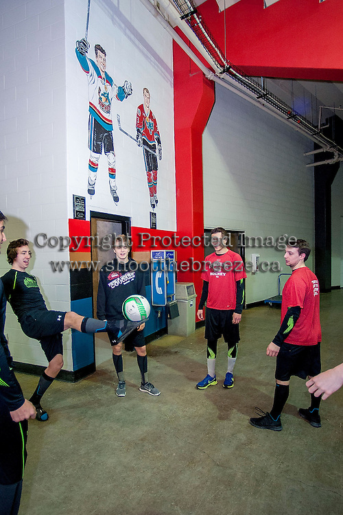 KELOWNA, CANADA -FEBRUARY 25:  The Prince George Cougars warms up with teammates at the Kelowna Rockets below the mural of Kelowna Rockets' alumni and current NHL players, 2014 Olympic Men's Hockey and 2009 World Junior Championship gold medalist, Jamie Benn and 2009 World Junior Championship gold medalist, Tyler Myers on February 25, 2014 at Prospera Place in Kelowna, British Columbia, Canada.   (Photo by Marissa Baecker/Getty Images)  *** Local Caption *** Tyler Mrkonic; Jamie Benn, Tyler Myers;