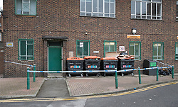 © Licensed to London News Pictures. 20/03/2017. London, UK.  Police tape surrounds an area of rubbish bins at the scene at a block of flats in Hoxton where a man's body was found. Officers found the victim, in his 20s, who  was unresponsive shortly after 12.30pm on Sunday. A murder investigation has been launched after a 28 year old man was arrested. Photo credit: Peter Macdiarmid/LNP