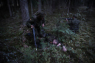 Young recruits train in the forests in Central Lithuania. A great number of reservists participate in in-the-field training session over the weekend, only to resume their ordinary lives during the rest of the week .