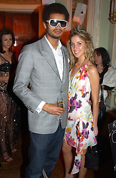 MISS AYESHA MAKIM niece of Sarah, Duchess of York and STEVE WOOD at a party to celebrate Pamela Anderson's new role as spokesperson and newest face of the MAC Aids Fund's Viva Glam V Campaign held at Home House, Portman Square, London on 21st April 2005.<br />