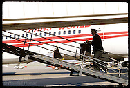 TWA pilot, Captain James Chick, walks aboard MD80 from tarmac @ Lambert Intl Airport; St. Louis. Missouri