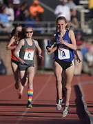 Apr 26, 2018; Philadelphia, PA, USA; Kelsey Chmiel  runs the 1,600m anchor leg on the Saratoga Springs girls distance medley relay that won the Championship of America race in 11:59.31 during the 124th Penn Relays at Franklin Field.