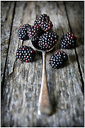 BLACKBERRIES ON WOOD.