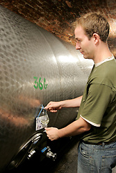 CZECH REPUBLIC MORAVIA DOLNI DUNAJOVICE 9SEP05 - A wineyard worder samples white wine stored in a metal container in a wine cellar underground. Southern Moravia's centuries-old traditions in wine growing make it a well-established wine region...jre/Photo by Jiri Rezac..© Jiri Rezac 2005..Contact: +44 (0) 7050 110 417.Mobile:  +44 (0) 7801 337 683.Office:  +44 (0) 20 8968 9635..Email:   jiri@jirirezac.com.Web:     www.jirirezac.com..© All images Jiri Rezac 2005 - All rights reserved.