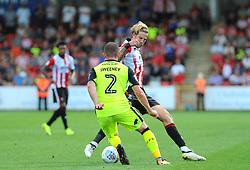Pierce Sweeney of Exeter City competes with Harry Pell of Cheltenham Town -Mandatory by-line: Nizaam Jones/JMP - 26/08/2017 - FOOTBALL - LCI Rail Stadium - Cheltenham, England - Cheltenham Town v Exeter City - Sky Bet League Two