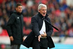 Stoke City manager Mark Hughes reacts angrily ahead of Southampton manager Mauricio Pellegrino - Mandatory by-line: Matt McNulty/JMP - 30/09/2017 - FOOTBALL - Bet365 Stadium - Stoke-on-Trent, England - Stoke City v Southampton - Premier League