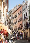 Historic buildings architecture tourist shops in Cuesta de Gomerez street, Granada, Spain