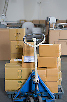 Boxes stacked on trolley in distribution warehouse