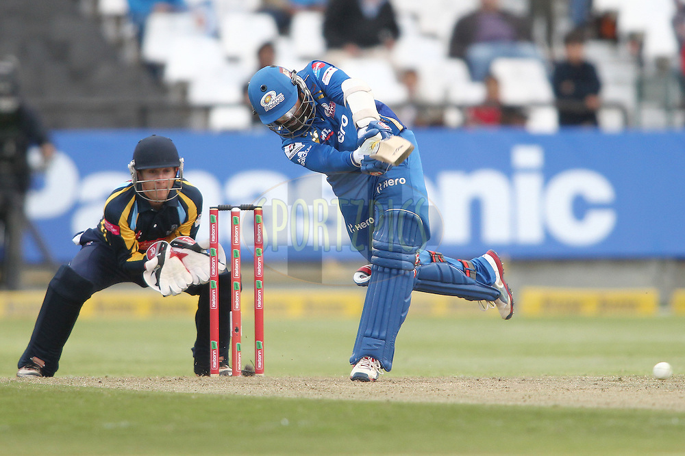 Dinesh Karthik of the Mumbai Indians attacks a delivery during match 11 of the Karbonn Smart CLT20 South Africa between The Mumbai Indians and Yorkshire held at Newlands Stadium in Cape Town, South Africa on the 18th October 2012..Photo by Shaun Roy/SPORTZPICS/CLT20