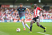 Brentford Midfielder Toumani Diagouraga beats off Sheffield Wednesday Forward Marco Matias to the ball during the Sky Bet Championship match between Brentford and Sheffield Wednesday at Griffin Park, London, England on 26 September 2015. Photo by Phil Duncan.