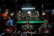 16th BC French unit soldiers have rest playing billards on September 23, 2012  in Warehouse base in Kabul. The French unit from Bitche (Moselle) will spend a week disassembling weapons, cleanning tanks and preparing their departure for France. AFP PHOTO / JEFF PACHOUD