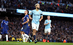 Manchester City's Sergio Aguero celebrates scoring his side's fifth goal of the game from the penalty spot and completing his hat-trick during the Premier League match at the Etihad Stadium, Manchester.