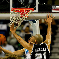 Jan 7, 2013; New Orleans, LA, USA; New Orleans Hornets shooting guard Eric Gordon (10) shoots over San Antonio Spurs power forward Tim Duncan (21) during  the first quarter of a game at the New Orleans Arena. Mandatory Credit: Derick E. Hingle-USA TODAY Sports