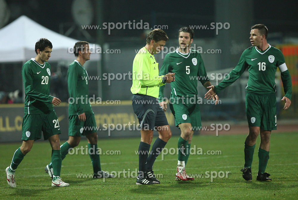 Branko Ilic (20), Mitja Morec (6), Bostjan Cesar (5) and Anton Zlogar (16) of Slovenia are angry to German referee Thorsten Kinhofer because of penalty shot for Denmark during the UEFA Friendly match between national teams of Slovenia and Denmark at the Stadium on February 6, 2008 in Nova Gorica, Slovenia.  Slovenia lost 2:1. (Photo by Vid Ponikvar / Sportal Images).