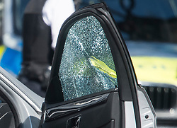 © Licensed to London News Pictures. 13/04/2019. London, UK.  A bullet hole and smashed glass in the window of a car at The scene in Holland Park after shots were fired near the Ukrainian embassy. Photo credit: Ben Cawthra/LNP