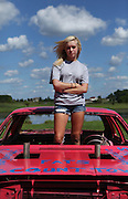 "Taylor ""Tee"" Krieter, 16, of Crown Point, recently drove in her first demolition derby at the Lake County Fair. The sport has been in the Krieter family for generations. Taylor's father Kevin Krieter has been the superintendent for the derby at the Lake County Fair for seven years and his father Don Krieter was the superintendent before him for 24 years. Kevin has driven demolition derby cars for over 30 years and was in his firs derby when he was 15..."