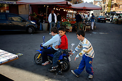 ITALY SICILY PALERMO 29APR08 - Children push a toy motorbike in the backstreets of Palermo, Sicily.. . jre/Photo by Jiri Rezac. . © Jiri Rezac 2008. . Contact: +44 (0) 7050 110 417. Mobile:  +44 (0) 7801 337 683. Office:  +44 (0) 20 8968 9635. . Email:   jiri@jirirezac.com. Web:    www.jirirezac.com. . © All images Jiri Rezac 2007 - All rights reserved.