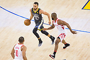 Golden State Warriors guard Stephen Curry (30) pushes the ball down the court against the Houston Rockets during Game 4 of the Western Conference Finals at Oracle Arena in Oakland, Calif., on May 22, 2018. (Stan Olszewski/Special to S.F. Examiner)