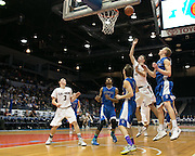 Will Van Auken of Caledonia-Mumford shoots over Sam Johnson of Geneseo during the Class C2 Sectional Championship game at Blue Cross Arena on Saturday, March 7, 2015.