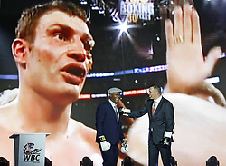 October 1, 2018 - Kiev, Ukraine - Ex heavyweight boxing champion Lennox Lewis (L) and Kiev's Mayor and ex heavyweight boxing champion Vitali Klitschko (R) look on a screen a video of their boxing fight on 2003 in Los Angeles and discussing during an official opening of the 56th WBC ( World Boxing Council ) Convention in Kiev, Ukraine, 01 October, 2018. The 56th WBC Convention takes place in Kiev from September 30 to October 05. The event participate of boxing legends Lennox Lewis, Evander Holyfield, Eric Morales, Alexander Usik, Vitali Klitschko and about 700 congress participants from 160 countries. (Credit Image: © Str/NurPhoto/ZUMA Press)