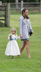 Jecca Craig  (former girl friend of Prince William ) with a brides Maid arrive at the wedding of James Meade and Lady Marsham the daughter of Earl of Romney in Gayton, Norfolk, United Kingdom. Saturday, 14th September 2013. Picture by i-Images