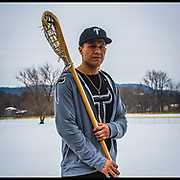 "Hiana Thompson on the Onondaga Reservation. Hiana plays professionally for the National Lacrosse League with the Georgia Swarm. ""My son is always runnin' around the house with his stick. We make sure we pass it on to them as soon as we can, that way they will carry the tradition to the next generation."""
