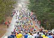A mass of runners make their way down Central Street during the 119th running of the Boston Marathon through Wellesley, April 20, 2015.   (Wicked Local Photo/James Jesson).