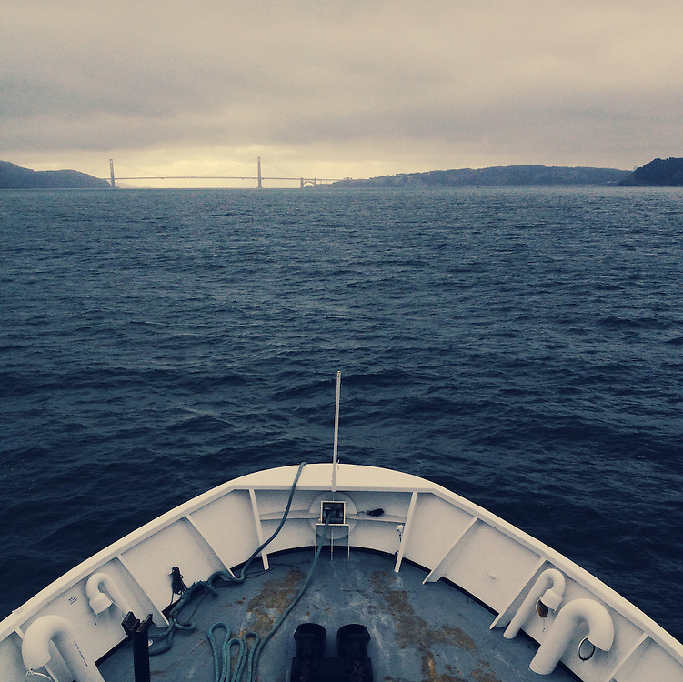 Research Vessel Ocean Starr departing San Francisco, Calif., for a survey trip through the Great Pacific Garbage Patch. The Golden Gate Bridge is along the horizon. Taken with an iPhone