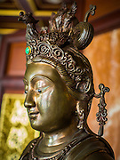 24 AUGUST 2014 - BANGKOK, THAILAND: A statue of Guanyin (also known as Quan Yin, Kwan Yin, or Kuanyin) an East Asian goddess of mercy, and a bodhisattva associated with compassion as venerated by Mahayana Buddhists at the Chee Chin Khor temple in Bangkok. Chee Chin Khor Moral Up-Lifting for Benefiction Foundation in a Chinese style temple on the Thonburi side of the Chao Phraya River in Bangkok. It blends aspects of Taoism, Buddhism (both Theravada and Mahayana), Islam, and Christianity religious traditions. Members of the temple perform community services throughout Bangkok.       PHOTO BY JACK KURTZ