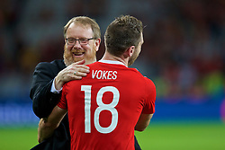 LILLE, FRANCE - Friday, July 1, 2016: Wales head of international affairs Mark Evans hugs Sam Vokes as they celebrate the 3-1 victory against Belgium at full time after the UEFA Euro 2016 Championship Quarter-Final match at the Stade Pierre Mauroy. (Pic by Paul Greenwood/Propaganda)