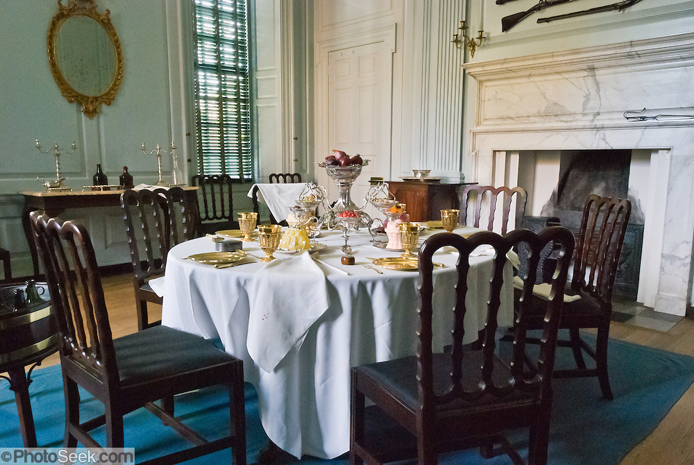 1700s Style Place Settings And Furniture Gather Around A Dining Table At The Governors Palace On