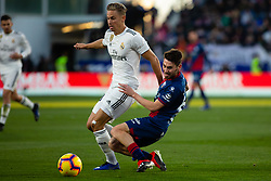 December 9, 2018 - Huesca, Aragon, Spain - Marcos Llorente of Real Madrid (18) competes for the ball with Moi Gomez of SD Huesca (6) during the LaLiga match between SD Huesca and Real Madrid at El Alcoraz. (Credit Image: © Daniel Marzo/Pacific Press via ZUMA Wire)
