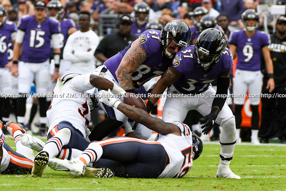 BALTIMORE, MD - OCTOBER 15: Baltimore Ravens tight end Maxx Williams (87) fumbles in the second quarter and the ball is recovered by Chicago Bears inside linebacker Danny Trevathan (59) on October 15, 2017, at M&T Bank Stadium in Baltimore, MD.  (Photo by Mark Goldman/Icon Sportswire)