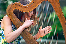 Edinburgh, Scotland, UK. 25 April, 2019. Tradfest kicks off it's 7th year  on Friday 25 April in Edinburgh. Tradfest mixes the best of traditional music, world cinema celebrating folk cultured storytelling. Pictured clarsach player Savourna Stevenson in the Scottish Book Trust Garden in Edinburgh.