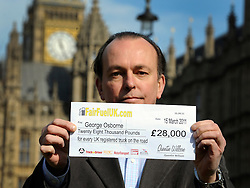 ©London News pictures. 10/03/11.Quentin Willson holds up a fair fuel 'cheque' representing the amount of duty an average lorry pays of fuel duty per year. Quentin Willson leads a Fuel Tax protest on College Green outside Parliament, holding a giant cheque to represent the £26 billion Britons pay in fuel duty each year, the campaign was organised by www.fairfueluk.com. Picture Credit should read Stephen Simpson/LNP