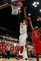 Nov 14, 2011; Stanford CA, USA;  Stanford Cardinal forward/center Josh Owens (13) grabs a rebound in front of Fresno State Bulldogs forward Kevin Foster (24) during the first half of a preseason NIT game at Maples Pavilion. Mandatory Credit: Jason O. Watson-US PRESSWIRE
