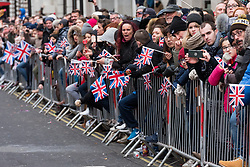 © Licensed to London News Pictures. 01/01/2018. Spectators watch the London's New Year's Day Parade on 1 January 2017 in central London. The event is one of the world's great street spectaculars with up to 10,000 performers from around the world and hosts marching bands, cheerleaders, leading companies, unions and local boroughs celebrating the arrival of 2017.London, UK. Photo credit: Ray Tang/LNP
