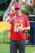 Jan 23, 2019; Kissimmee, FL, USA; Former Buffalo Bills quarterback Jim Kelly (12) acknowledges the crowd during the 2019 Pro Bowl Skills Challenge at ESPN Wide World of Sports Complex. (Steve Jacobson/Image of Sport)
