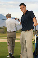 Young Man on Golf Course with Older man