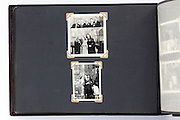 vintage photo album page with family group images that are partly double exposed