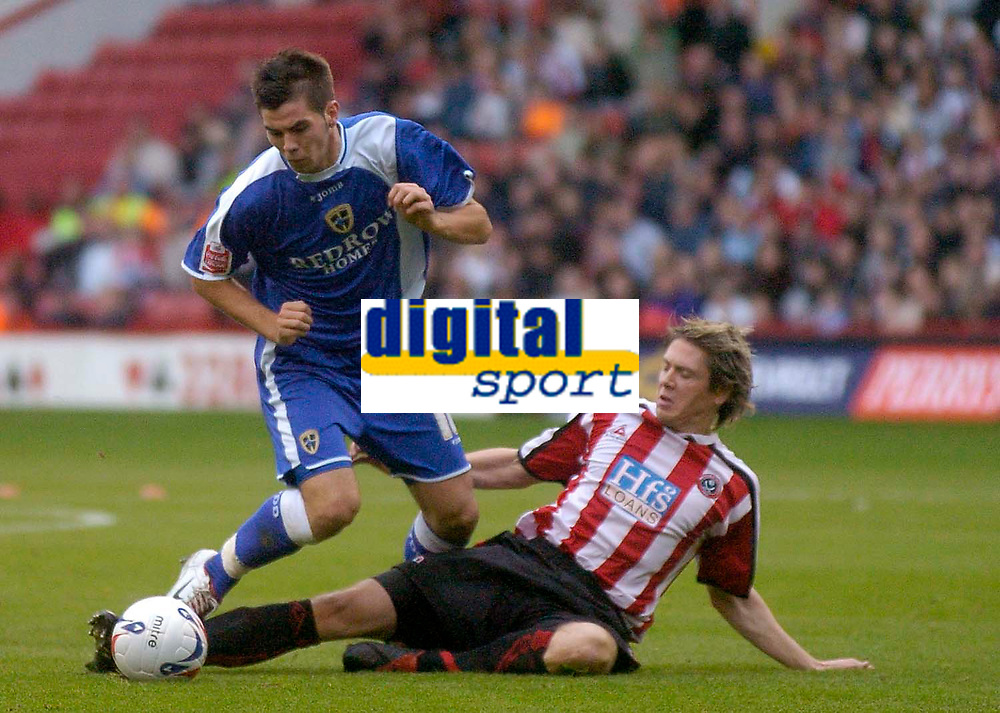Photo: Glyn Thomas.<br />Sheffield Utd v Cardiff City. Coca Cola Championship.<br />29/10/2005.<br />Sheffield's Leigh Bromby (R) slides in to tackle Cardiff's Joe Ledley.