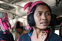 A woman from a northern Laotian hilltribe catches a ride on a southbound bus.