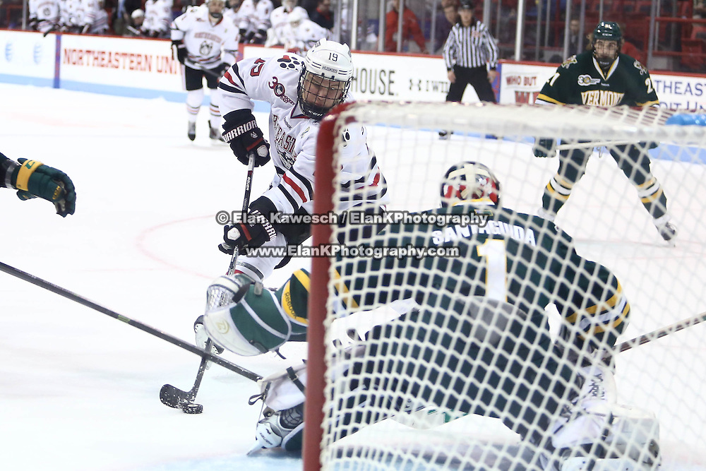 Mike Szmatula #19 of the Northeastern Huskies shoots the puck during the game at Matthews Arena on January 18, 2014 in Boston, Massachusetts. (Photo by Elan Kawesch)