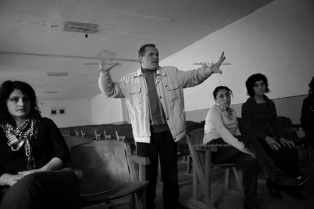 "Actors of Shushi theater during a rehearsal. Director Leonid gestures (c.). This image is part of the photoproject ""The Twentieth Spring"", a portrait of caucasian town Shushi 20 years after its so called ""Liberation"" by armenian fighters. In its more than two centuries old history Shushi was ruled by different powers like armeniens, persians, russian or aseris. In 1991 a fierce battle for Karabakhs independence from Azerbaijan began. During the breakdown of Sowjet Union armenians didn´t want to stay within the Republic of Azerbaijan anymore. 1992 armenians manage to takeover ""ancient armenian Shushi"" and pushed out remained aseris forces which had operate a rocket base there. Since then Shushi became an ""armenian town"" again. Today, 20 yeras after statement of Karabakhs independence Shushi tries to find it´s opportunities for it´s future. The less populated town is still affected by devastation and ruins by it´s violent history. Life is mostly a daily struggle for the inhabitants to get expenses covered, caused by a lack of jobs and almost no perspective for a sustainable economic development. Shushi depends on donations by diaspora armenians. On the other hand those donations have made it possible to rebuild a cultural centre, recover new asphalt roads and other infrastructure. 20 years after Shushis fall into armenian hands Babies get born and people won´t never be under aseris rule again. The bloody early 1990´s civil war has moved into the trenches of the frontline 20 kilometer away from Shushi where it stuck since 1994. The karabakh conflict is still not solved and could turn to an open war every day. Nonetheless life goes on on the south caucasian rocky tip above mountainious region of Karabakh where Shushi enthrones ever since centuries."