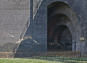 Three concentric arches, part of a rail bridge over a canal in Manchester, England